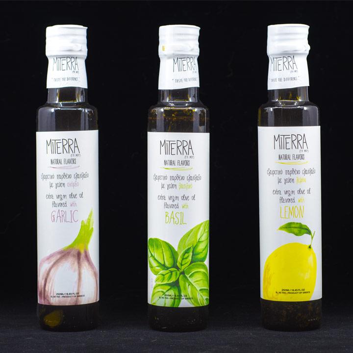 Drie heerlijke Griekse extra vergine olijfolies verrijkt met knoflook, basilicum en citroen